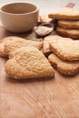 Cookies with sesame seeds in the shape of heart — Stock Photo