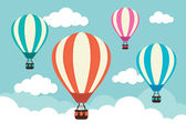 Hot Air Balloons and Clouds — Stock Vector