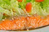 Salmon steak on top with sauce — Stock Photo