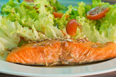 Salmon steak on top with sauce — Stock Photo