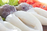 Boiled squid with salad leaves — Stock Photo