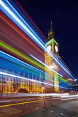Big Ben behind light beams at twilight time, London, UK — Stock Photo