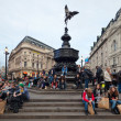 Piccadilly Circus in London. Memorial fountain with Anteros - Stock Photo