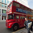 Stock Photo: Routemaster departs from bus stop, London