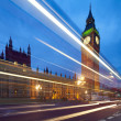 Big Ben behind light beams at twilight time, London, UK - Stock Photo