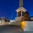 Pedestal Nelson's Column in Trafalgar Square with four lions lyi — Stock Photo