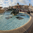 Trafalgar Square fountain in London, United Kingdom — Stock Photo