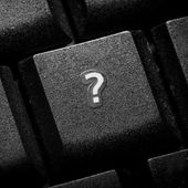 Question sign on keyboard button — Stock Photo