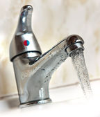 Water runing from tap — Stock Photo