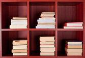 Books on bookshelves — Stock Photo