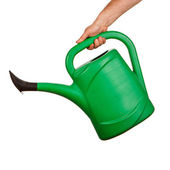 Hand holding plastic watering can — Stock Photo