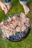 Grilled meat on a charcoal grill — Stock Photo