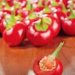 Cut round hot chilly pepper on table — Foto de stock #27143823