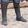 Stock Photo: Legs of min boots of dark ages