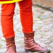 Legs of a man in the boots of a dark ages — Stock Photo
