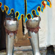 Stock Photo: Legs of medieval knight in armour boots of dark ages