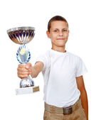 Boy holding sport  cup with smile — Stock Photo