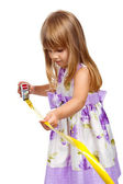 Little girl with measuring tape — Stock Photo