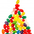 Color jelly beans in shape of triangle over a  — Stock Photo