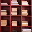 Books on a brown shelf — Stock Photo