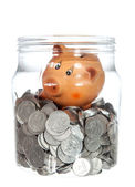 Glass jar with coins and ceramic piggy bank — Foto Stock