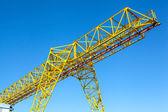 Gantry crane over blue sky — Stock Photo