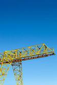 Gantry crane over blue sky — 图库照片
