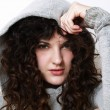 Young woman in hood posing — Stock Photo