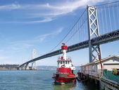 San Francisco Bay Bridge with a red ship — Stock Photo