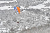 Paraglider flying in winter environment — Stock Photo