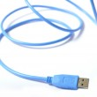 Blue USB cable on white background — Stock Photo