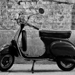 Scooter in front of a wall — Stock Photo