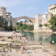 Stock Photo: MOSTAR, BOSNIA-HERCEGOVINAUGUST 10: Tourist at old bridge