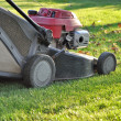 Lawnmower at autumn — Stock Photo #35712499
