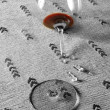 Stock Photo: Red wine in broken glass half desaturated