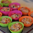 Cooking muffins in colourful plastic cups — Stock Photo #39680421