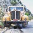 Yellow old truck in the mountain — Stock Photo