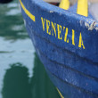 Old blue rowboat named Venezia — Stock Photo