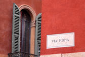 Via Roma street sign in the old town of Verona — Stock Photo