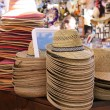 Straw hats at a market stall in Verona — Stock Photo