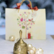 Royalty-Free Stock Photo: Golden Christmas bell, Christmas balls and gift bag