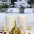 Golden Christmas bell and coffee cups, Christmas balls and coffe - Stock Photo