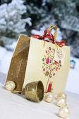 Golden Christmas bell, Christmas balls and gift bag — Stock Photo