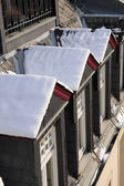 Snowy dormer windows at old building — Stock Photo