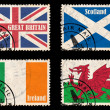 Set of stamps with flags from the British Isles - Stock Photo