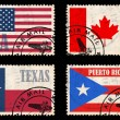 Set of stamps with flags from North America — Stock Photo #19640723