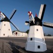 Windmill and model of a windmill — Stock Photo