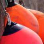 Red and orange buoys — Stock Photo