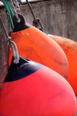 Red and orange buoys — Stock Photo