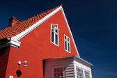 Bright red house on Bornholm — Stock Photo